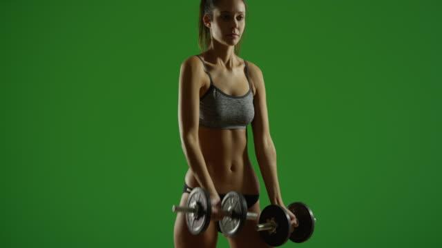 vídeos y material grabado en eventos de stock de young white woman lifts weights in contrasty lighting on green screen - brazo humano