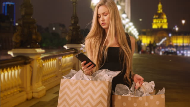 young white woman out shopping in paris standing on pont alexandre iii - pont alexandre iii stock videos & royalty-free footage