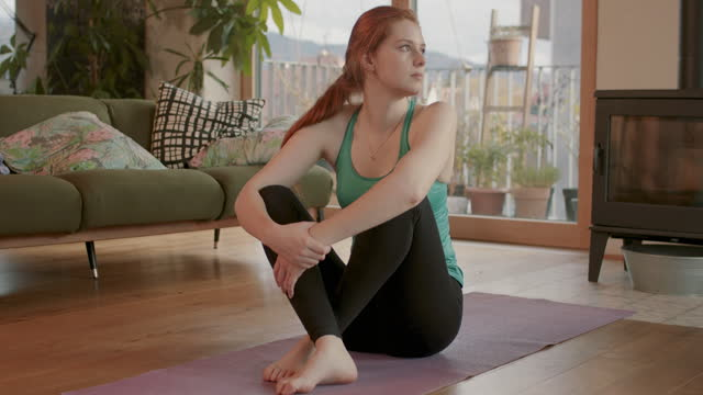 young woman alone in living room on yoga mat - pilates stock videos & royalty-free footage
