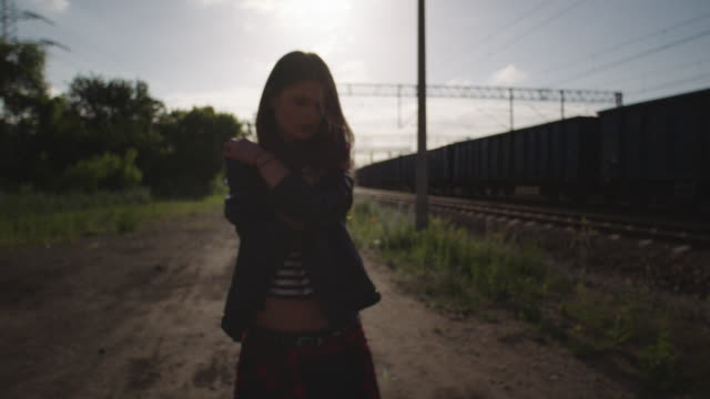 Young woman alone on the railway.