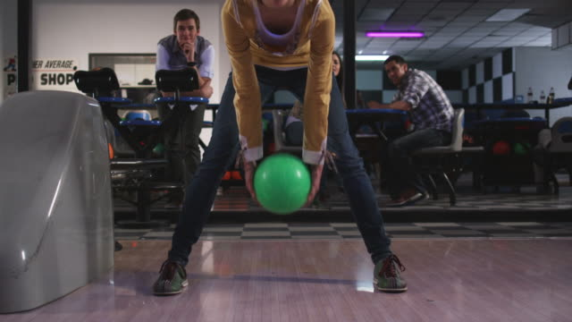 young woman and friends at a bowling alley - amateur stock videos & royalty-free footage
