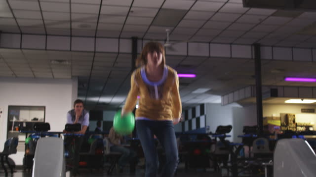 young woman and friends at a bowling alley - bowling ball stock videos & royalty-free footage