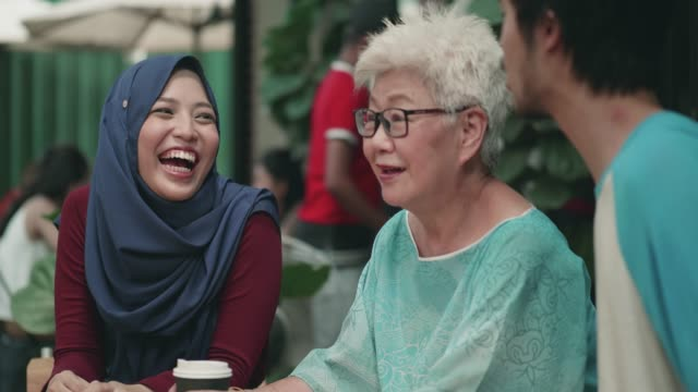 young woman and man spending time with grandmother - malaysia stock videos & royalty-free footage