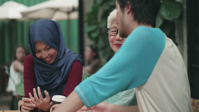 young woman and man spending time with grandmother - malaysian culture stock videos and b-roll footage