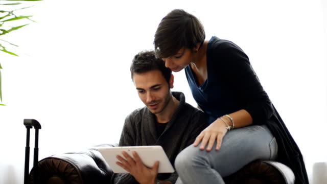 Young woman and man using a tablet