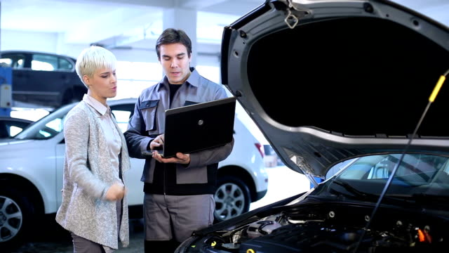 young woman and mechanic. - repair garage stock videos & royalty-free footage
