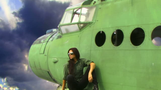 young woman and old plane - air force stock videos & royalty-free footage