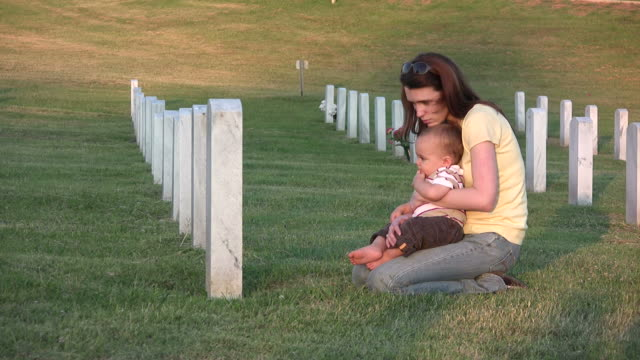 young woman and son visit grave hd - gravestone stock videos & royalty-free footage