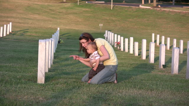 young woman and son visit grave hd - memorial stock videos & royalty-free footage