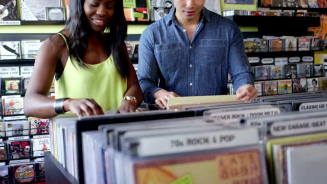 MS A Young Woman and Young Man flick through vintage records together