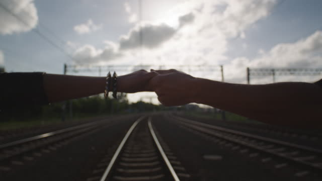 young woman and young womang walking together on the railway. rock and roll style. - rock and roll video stock e b–roll