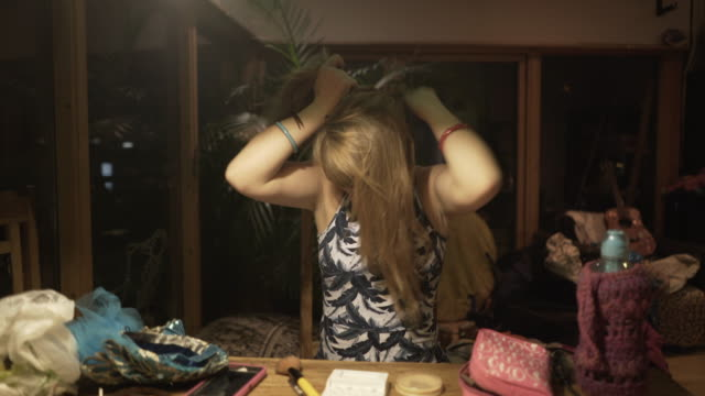 a young woman applying a costume head piece. - bangs stock videos & royalty-free footage