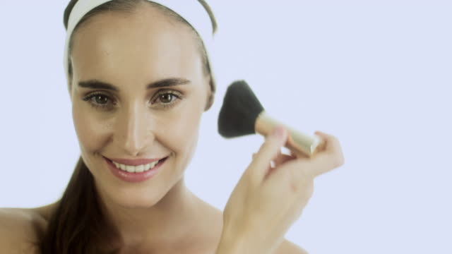 young woman applying blusher - hair accessory stock videos and b-roll footage