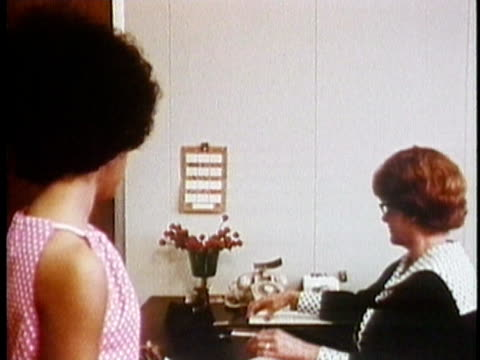 1971 MONTAGE TS Young woman applying for a job, filling out form / USA / AUDIO