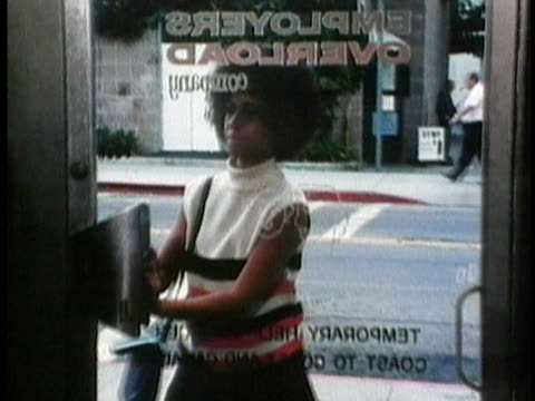 1971 MONTAGE PAN MS ZO Young woman applying for a job / USA / AUDIO