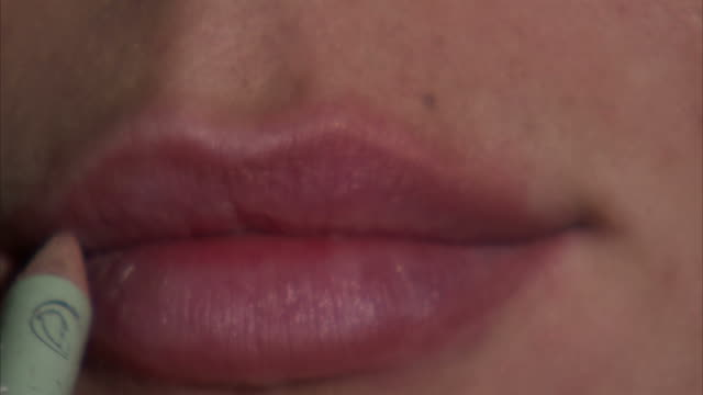 ecu young woman applying lip liner / orem, utah, usa - lip liner stock videos & royalty-free footage