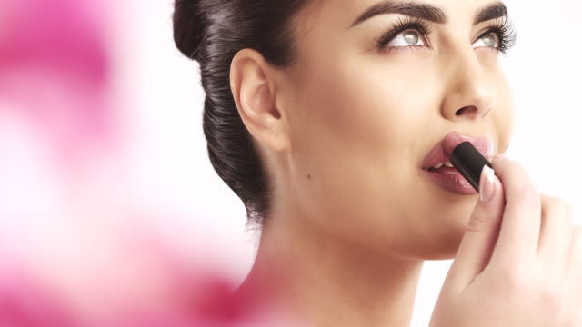 young woman applying lipstick - lipstick stock videos & royalty-free footage