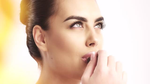 Young Woman Applying Lipstick