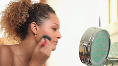 cu td pan young woman applying make-up in bathroom / richmond, virginia, usa - routine stock videos & royalty-free footage