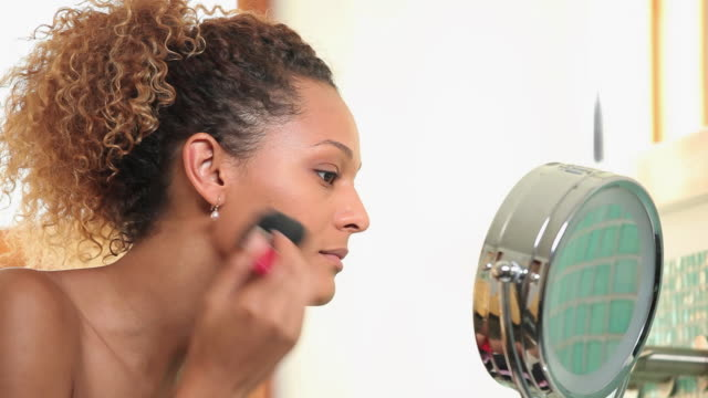 cu td pan young woman applying make-up in bathroom / richmond, virginia, usa - make up stock videos and b-roll footage