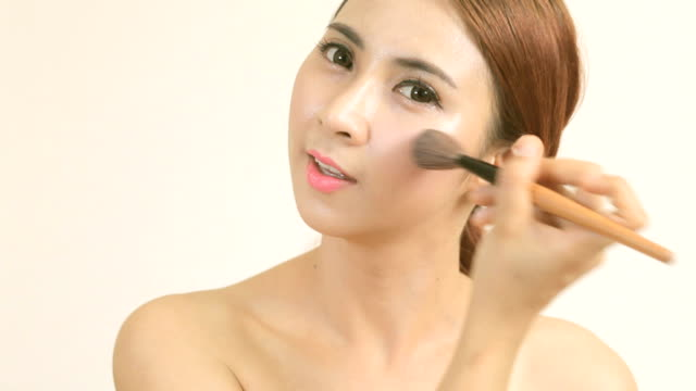 young woman applying makeup - blusher stock videos & royalty-free footage