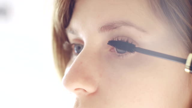 young woman applying mascara - blusher make up stock videos and b-roll footage