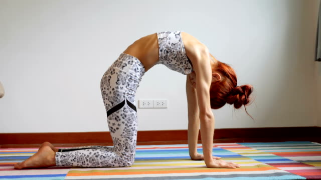 young woman are doing yoga exercises  in the morning - upside down stock videos & royalty-free footage