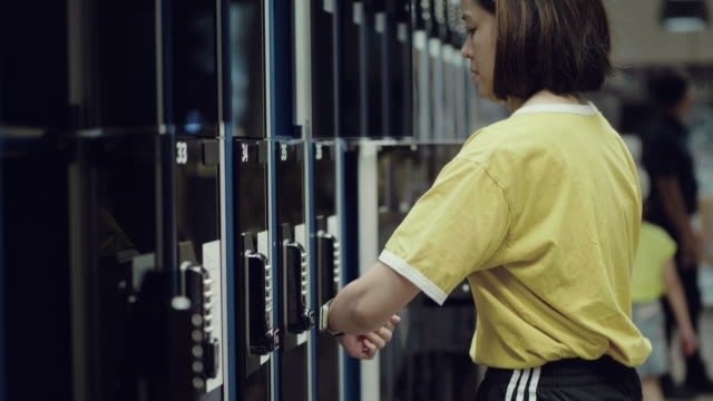 young woman are pressing the security lock code on locker. - combination lock stock videos & royalty-free footage