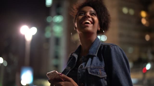 young woman are so excited visiting the city at night - urban sprawl stock videos & royalty-free footage