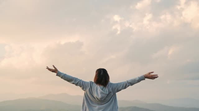 young woman arms outstretched relaxation and freedom on top mountain - arms outstretched stock videos & royalty-free footage
