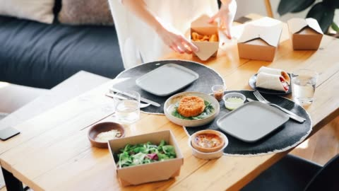 young woman arranging takeaway food on the table, getting ready for lunch - fast food stock videos & royalty-free footage