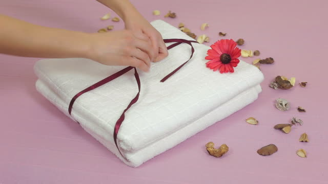 young woman arranging towels. - blanket texture stock videos and b-roll footage