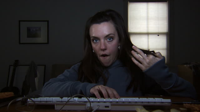 A young woman at a keyboard