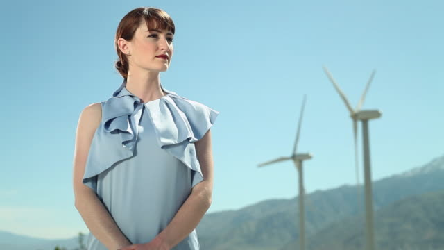young woman at a wind farm - bluse stock-videos und b-roll-filmmaterial