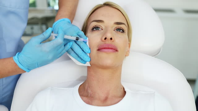 young woman at beauty treatment clinic - beauty stock videos & royalty-free footage