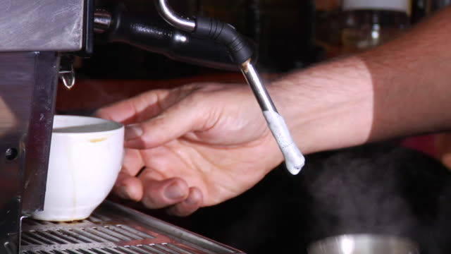 ms young woman at coffee shop counter/ td zi barista steaming milk and making cappuccino/ vancouver, bc - see other clips from this shoot 1100 stock videos & royalty-free footage