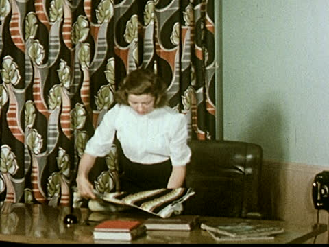 young woman at desk, working in interior design shop with fabric swatches. - home economics class stock videos & royalty-free footage