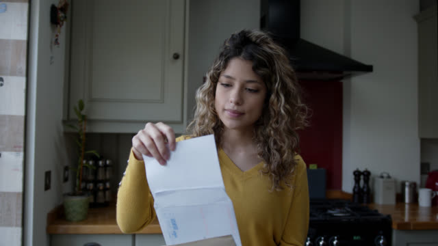 young woman at home opening her mail - correspondence stock videos & royalty-free footage