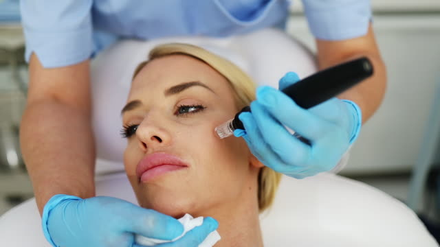 young woman at mesotherapy treatment - beauty treatment stock videos & royalty-free footage