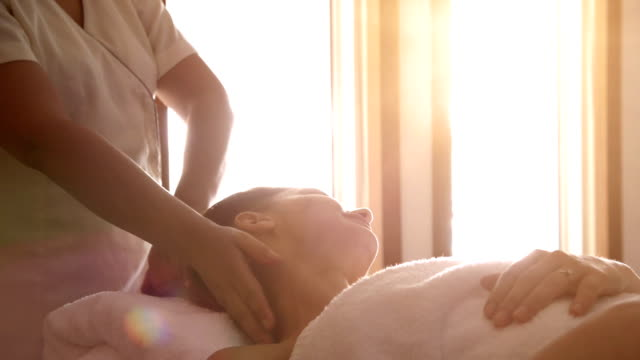 young woman at spa treatment - human head stock videos & royalty-free footage
