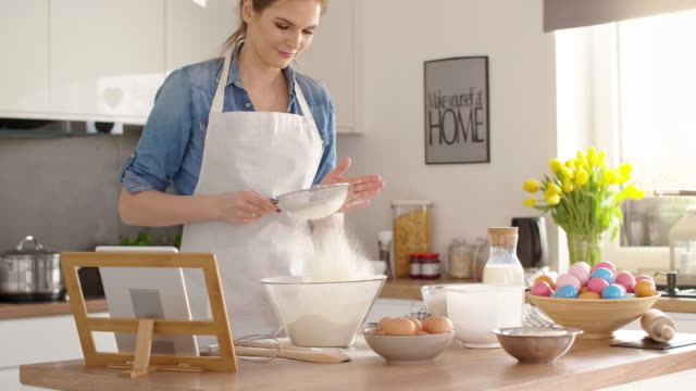 young woman baking a cake for easter/debica/poland - sifting stock videos and b-roll footage