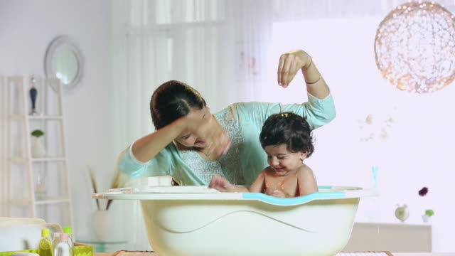young woman bathing her son - routine stock videos & royalty-free footage