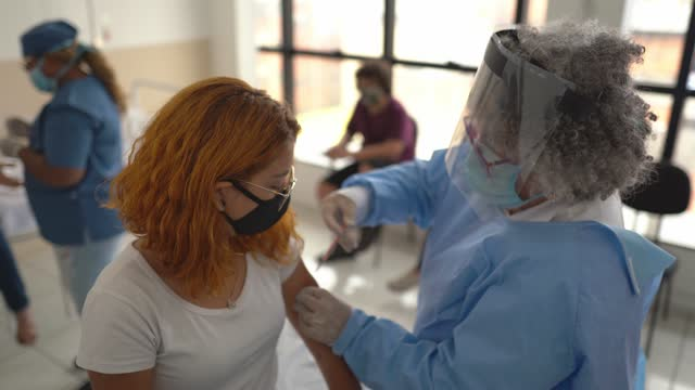 young woman being vaccinated - wearing face mask - latin america stock videos & royalty-free footage
