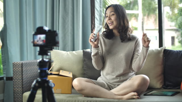 young woman blogger recording video for blogging review production - vlogging - following stock videos & royalty-free footage