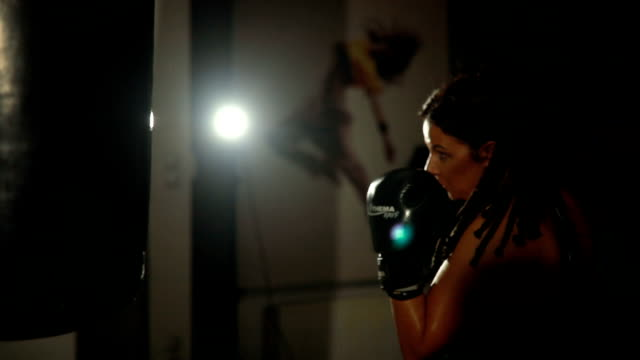 young woman boxing punching bag - punch bag stock videos and b-roll footage