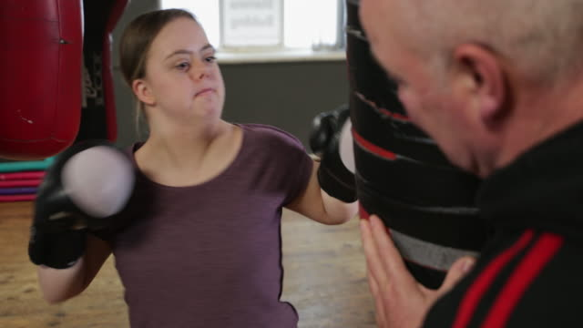 young woman boxing - newcastle upon tyne stock-videos und b-roll-filmmaterial