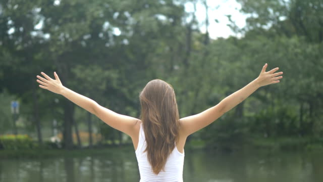 young woman breathing fresh air - breathing exercise stock videos & royalty-free footage