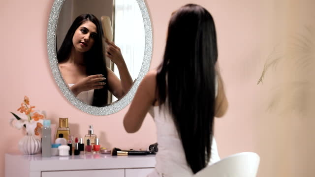 young woman brushing her hair, delhi, india - brushing hair stock videos & royalty-free footage