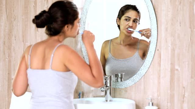 young woman brushing teeth in bathroom, delhi, india - brushing teeth stock videos & royalty-free footage