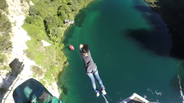 Young woman bungy jump in Tapou New Zealand